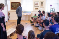 A performance of Cato & Dolly in Representatives Hall at the Old State House.