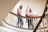 Visitors above the central staircase of the Old State House.