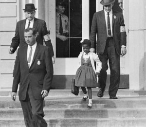 U.S. MARSHALS WITH YOUNG RUBY BRIDGES ON SCHOOL STEPS